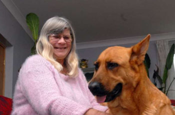 Woman with Type ! diabetes ad dog Gypsy who saved her life.