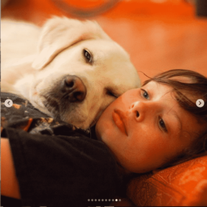 a boy and his best friend lying down together